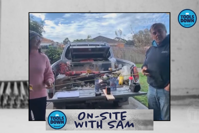 Sam interviews tradie Robert at the back of his ute.